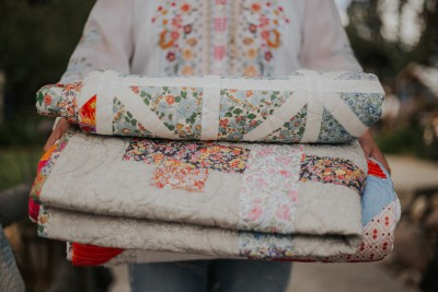 stack of quilts being carried